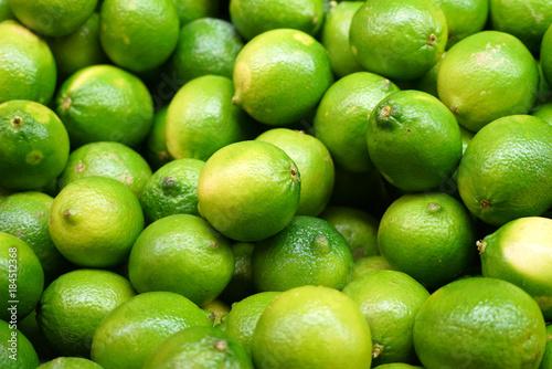Carta da parati Fresh green lime pile in harvest season