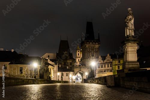 Charles bridge in Prague with lanterns at night Fotobehang