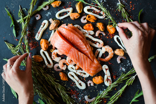 Food blogger making seafood ingredients layout. Leisure hobby art design concept