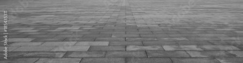 Fotografia, Obraz Grey brick stone street road. Light sidewalk, pavement texture
