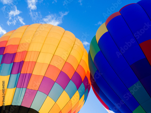 Fotografiet Two colorful hot air balloons on the ground ready to take off - at Winthrop Ball