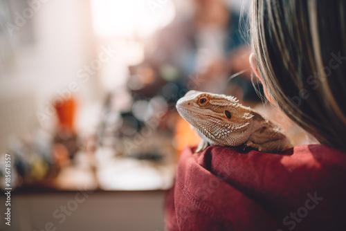 Lizard on girls shoulder
