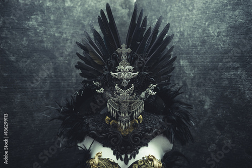 Horror, dark gothic dress formed by a silver metal tiara and a golden corset, ha Fototapeta