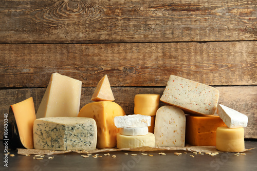 Different kinds of delicious cheese on table