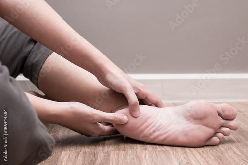 Fotografie, Tablou Female foot heel pain, plantar fasciitis