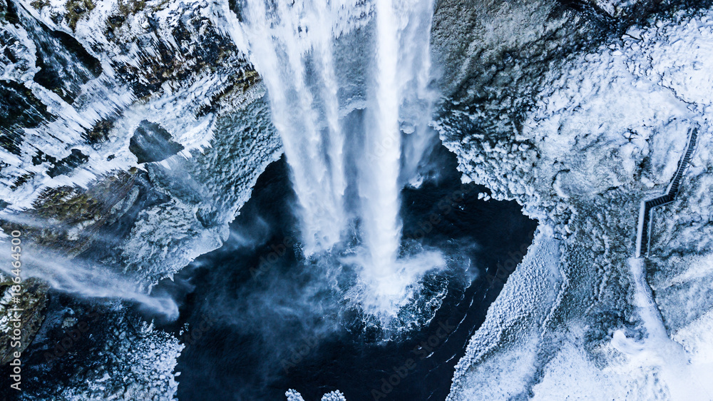 Aerial photo of the Seljalandsfoss waterfall in winter