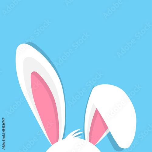 Fototapeta premium Wesołych Świąt z uszami królika na niebieskim tle