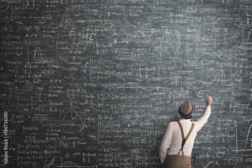 wise man writing mathematical problem solution
