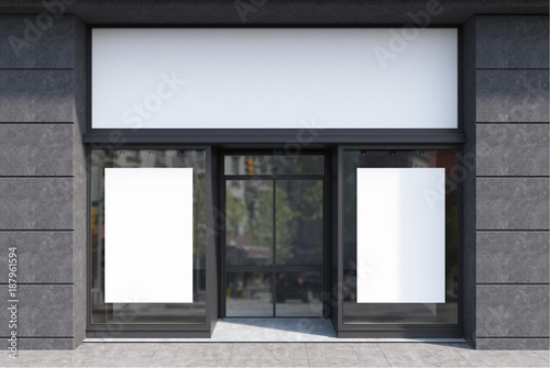 Photo Dark gray and white cafe facade, two posters
