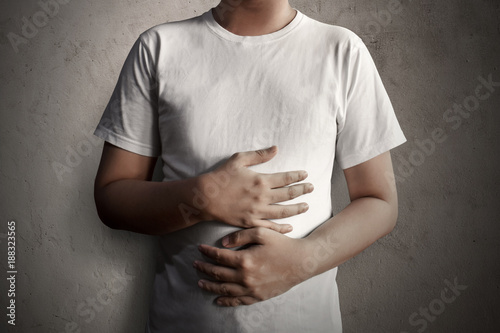 Fotografie, Obraz Man holding stomach