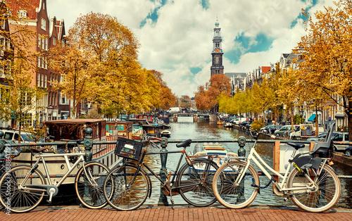 Fotografia Bike over canal Amsterdam city. Picturesque town landscape