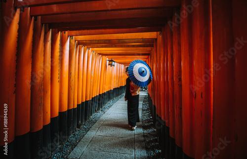 Beautiful japanese senior woman walking in the fushimi inari shrine in Kyoto Fototapeta