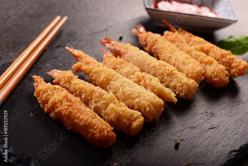Fried shrimps on sticks in crispy coating
