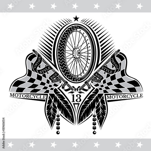Photo Motorbike wheel between crossed raced flags and indian feather