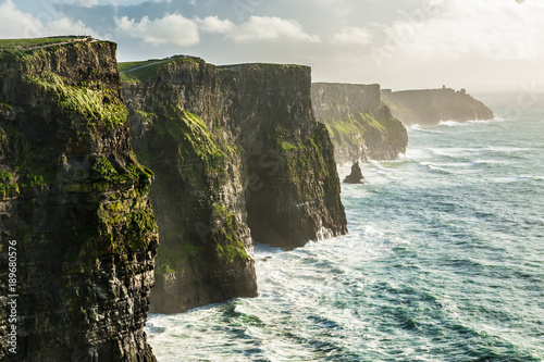 The Cliffs of Moher, Irelands Most Visited Natural Tourist Attraction, are sea cliffs located at the southwestern edge of the Burren region in County Clare, Ireland Fototapeta