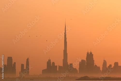 Canvas Print DUBAI SKYLINE UNDER SUNRISE, TWO LANDMARKS, BURJ AL ARAB AND BURJ KHALIFA, THE T