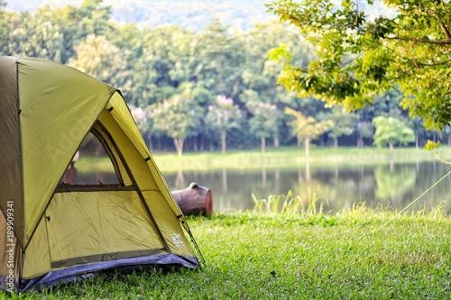 Camping green tent in forest near lake Tapéta, Fotótapéta