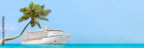 Cruise ship luxury travel caribbean vacation banner panorama in tropical holiday destination with palm tree and ocean background landscape with copy space on blue sky.