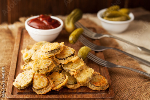 Battered fried pickles with ketchup
