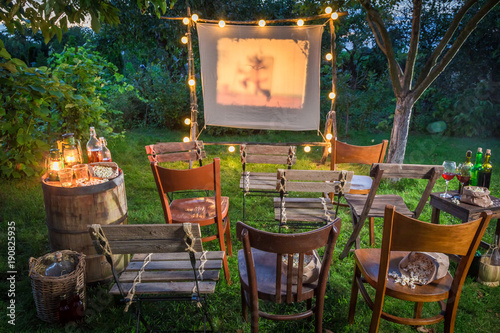 Summer cinema with retro projector in the garden