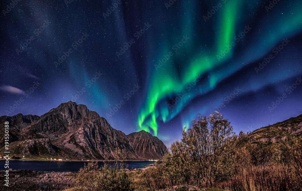 Northern lights explotion above Mt Stornappstinden in Lofoten