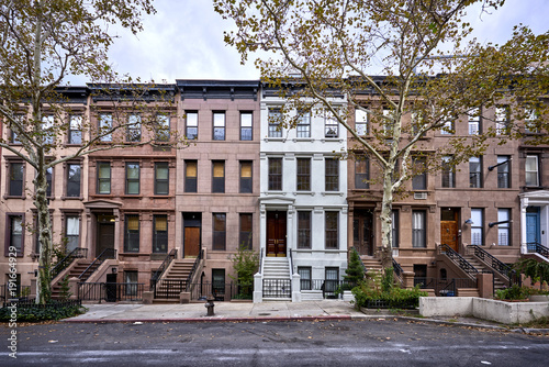 a view of a row of historic brownstone buildings in an iconic neighborhood of Ma Fototapeta