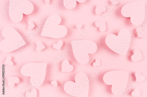 Paper pink hearts fly on soft pink color background. Valentine day concept for design.
