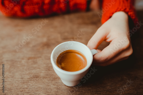 Obraz na plátně Woman is holding in hand hot coffee espresso in white small glass cup