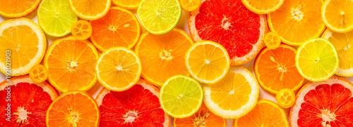 Fotografie, Obraz beautiful fresh sliced mixed citrus fruits like background, concept of healthy e