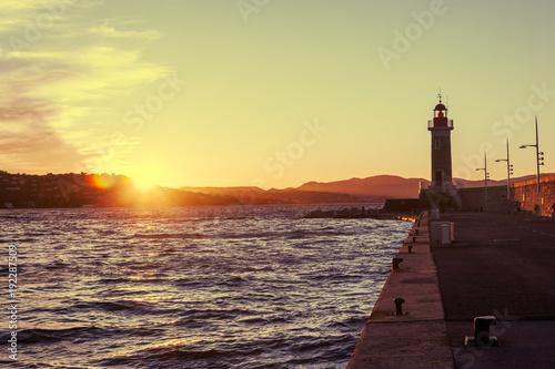 Fotografie, Obraz Bright beautiful colorful sunset, Lighthouse in Saint Tropez, France, Cote d Azu