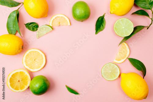 Lime and lemon frame on pink background
