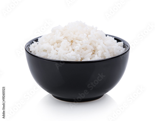 rice in black bowl on white background