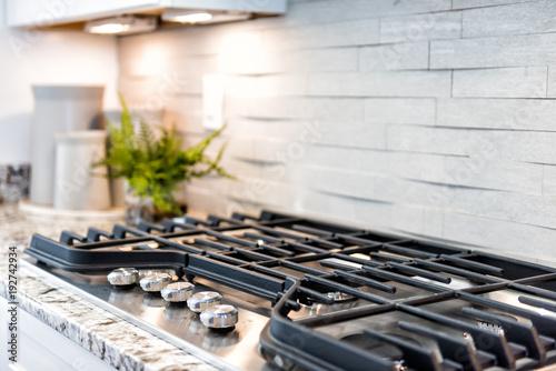 Fotografija Macro closeup of modern luxury gas stove top with tiled backsplash