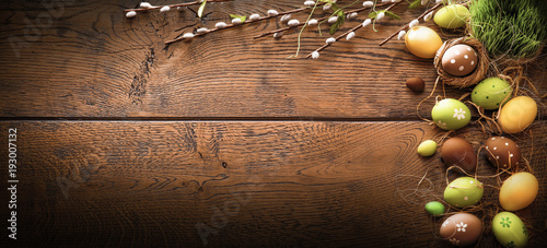 Easter Eggs with Branches on Wood Background