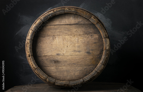 Photo background of barrel and worn old table of wood