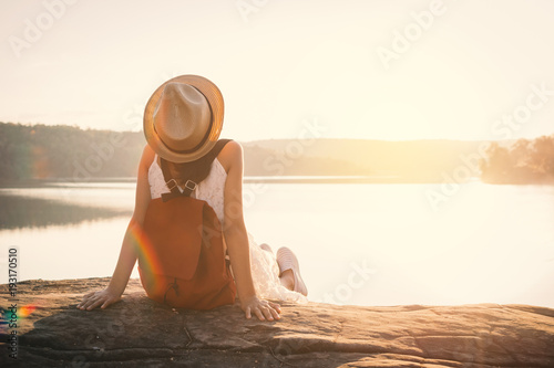 Asian girl backpack in nature during sunset , Relax time on holiday concept travel,selective and soft focus,color tone of hipster style #193170510