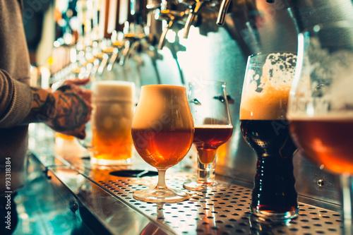 Fotografia, Obraz Glass of beer with barrel, bottle and fresh hops still-life