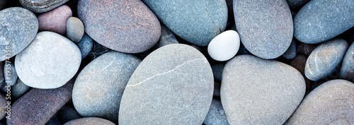 Fotografia Web banner abstract smooth round pebbles sea texture background