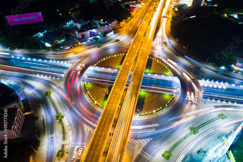 Roundabout intersection city road at night with vehicle light movement
