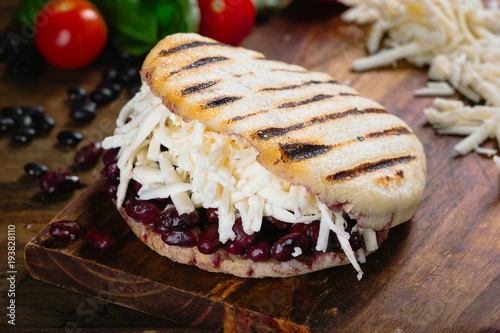 Arepa, corn bread with cheese and black beans