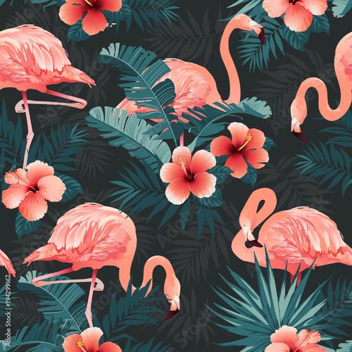 Fototapeta premium Piękny ptak Flamingo i tropikalne kwiaty tło. Wektor wzór.