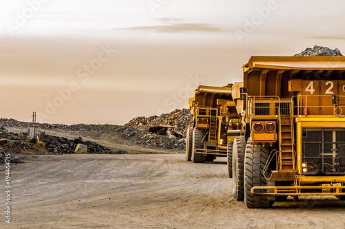 Wallpaper Mural Mining dump trucks transporting Platinum ore for processing
