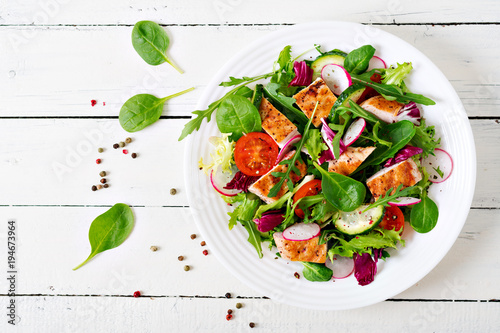 Wallpaper Mural Fresh vegetable salad with grilled chicken breast   - tomatoes, cucumbers, radish and mix lettuce leaves