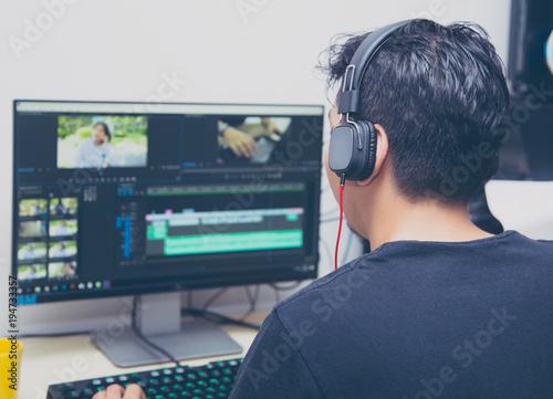 Obraz na plátně back view of video editor using computer