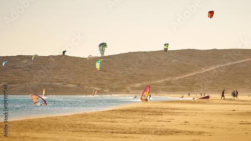 Windsurfers and kitesurfers riding at the Prasonisi beach at Rhodes island