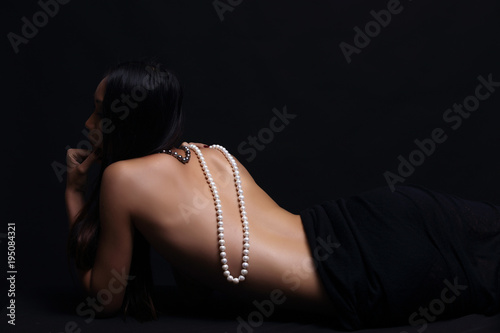 Canvas Print Portrait of beautiful nude long straight black hair woman with pearl necklace