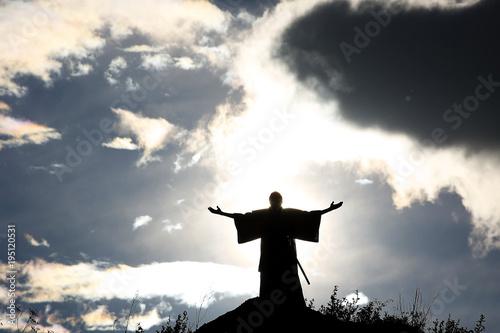 Fototapeta Silhouette monk on the mountain prayer moses faith god
