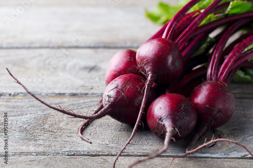 Fresh organic beet, beetroot on grey rustic wooden background. Copy space.