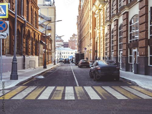 Cuadros en Lienzo urban street crosswalk sunny day road