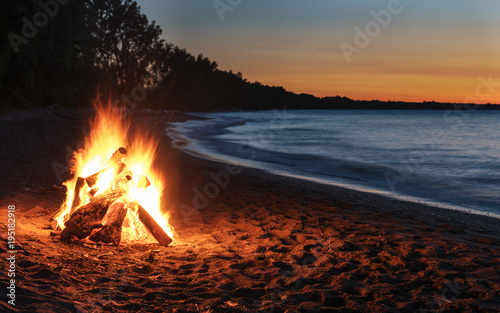 Glowing Bonfire on Beach at Sunset Fototapete